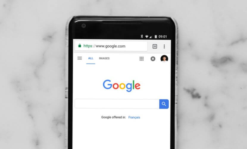 A smartphone lying on a countertop with Google SEO up