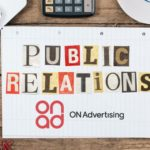 A lined sheet of paper that reads public relations and ON Advertising PR agency